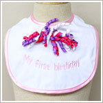 Ganz Pink/White *My First Birthday* Bib w/ Curly Ribbons