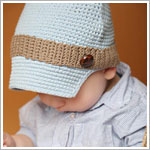 Z: Huggalugs Hat - Crocheted Blue Button Newsboy